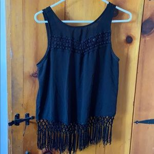 Top with open back and fringe on bottom